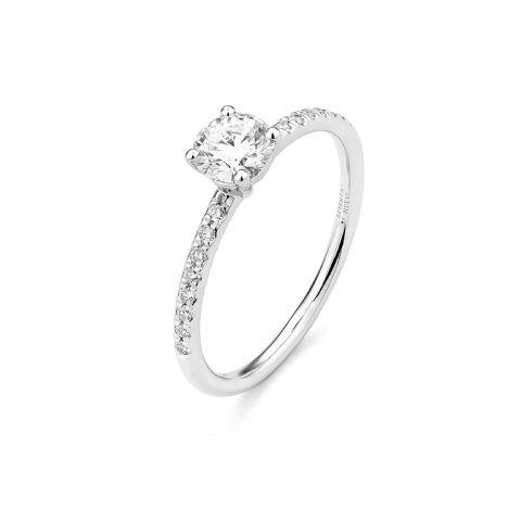 Bague solitaire Facet avec diamant central et brillants sur corps de bague en or blanc